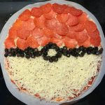 Celebrate the Pokemon lover in your life by making this quick and easy Pokeball pizza! You'll the hero of mealtime when you bring this out!